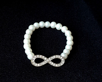 #BR13 Stunning Bracelet   Rhinestone Bow on a strand of Lustrous White Pearls . Stretch Elastic $35.
