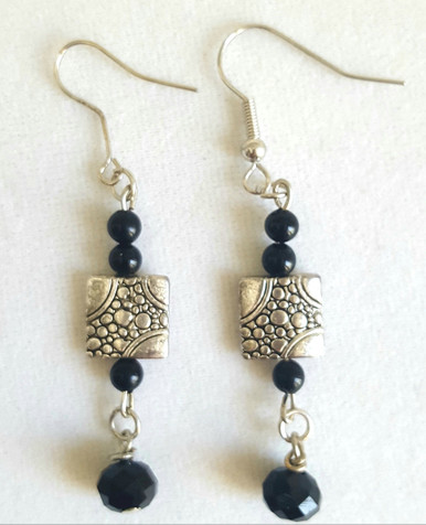 "Etched Silver Earrings with Faceted Black Accents 2"" Long. Available in wire, post or clip on $45."