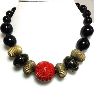 """#AN48 DRAMATIC LARGE CARVED CINNABAR WITH RIBBED METAL AND  LARGE BLACK BEADS $150.  18"""" LONG BUT MAY BE CUSTOM ORDERED IN CUSTOM SIZE FOR A SMALL ADDITIONAL CHARGE.  I CAN ALSO MAKE AN EARRING TO MATCH THIS ON REQUEST."""