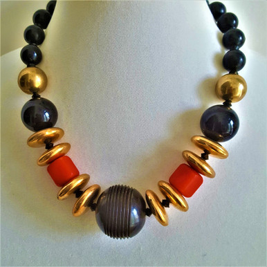 """#AN72  LARGE BLACK CARVED BONE CENTER WITH GOLD DISCS AND AND BRIGHT RED ACCENTS $85  18"""" OR 20"""" LONG, PLEASE SPECIFY. CUSTOM SIZE IS AVAILABLE FOR A SLIGHT INCREASE IN PRICE."""
