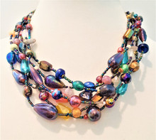 "#AN39 Six Strands of Fabulous Colorful Vintage Hand Blown Glass Beads strung and designed by jewelry artist Lois Becker. Price: $155.   Each necklace ordered will vary slightly but will have the same wonderful effect. Length 18"" .   Available in custom size to fit your needs for a slight extra charge"