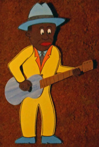 Cut-out Bluesman Playing Guitar by George Borum