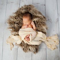 Adorable bright picture of sleeping newborn in studio. Image by Emotion Studios of Wolverhampton.