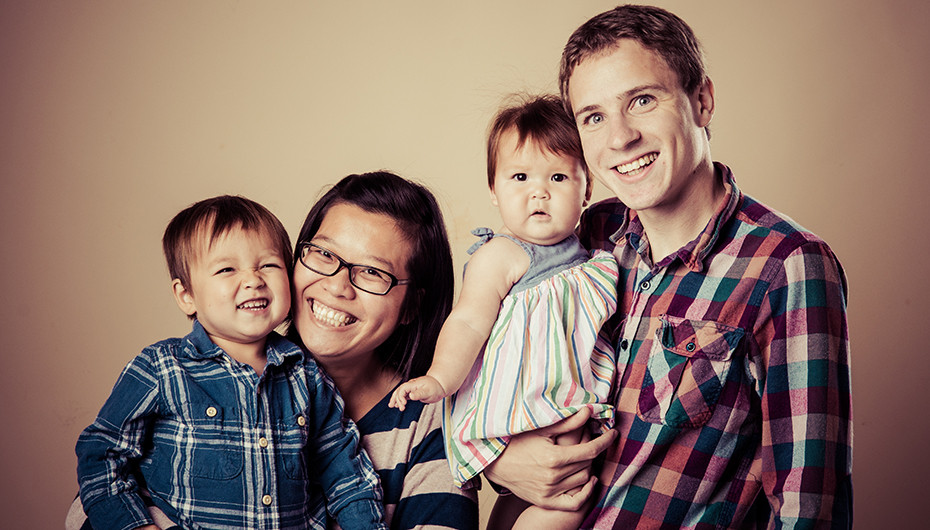 Fun, smiling family portrait. Photograph by Emotion Studios.