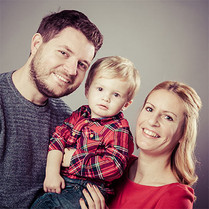 Happy family picture taken by Emotion Studios.