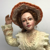 Closer facial view of Windswept Woman Doll