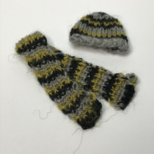 Miniature knitted hat and scarf