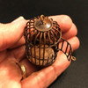 Dollhouse birdcage rusted and in hand