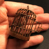 Side view of rusted dollhouse bird cage