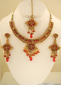 Intricate designed set with pear shaped Red & clear stones set against gold background-JCB130