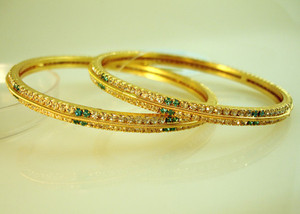 Gold plated bangles studded with Green & Clear cubic zirconia stones-109BA45