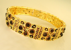 Gold plated bangles embedded with red colored stones-BAN859