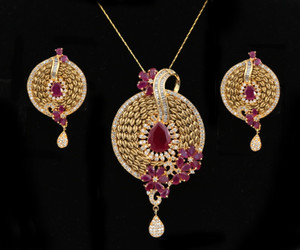 Women's Unique Handcrafted Golden Look Round shaped flowery designed Pendant Set with Ruby Stones