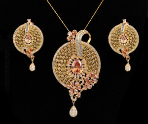 Women's Unique Handcrafted Golden Look Round shaped flowery designed Pendant Set with Topaz Stones