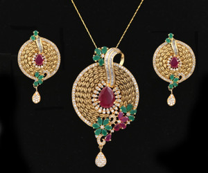 Women's Unique Handcrafted Golden Look Round shaped flowery designed Pendant Set with Ruby and Emerald Stones