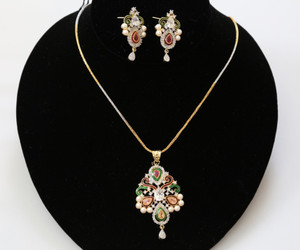 AD pendant necklace with matching earrings