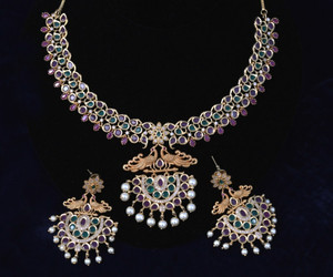 Magnificent Traditional Designed Necklace, Ruby Emerald stones studded with matching pair of earrings.