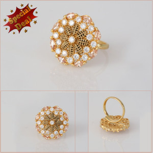 Gold Tone Ring for girls | Floral design color stones set against a gold background.