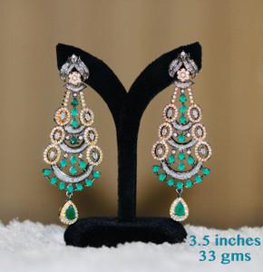 Pear shaped emerald stone earrings