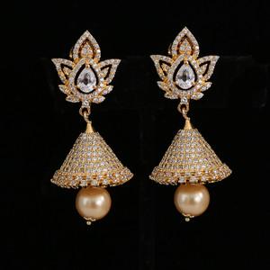 white stones jhumka earrings
