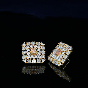 Topaz Simulated stone stud earrings in a Gold plated background.