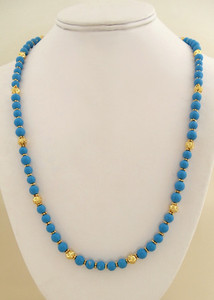 Turquoise Beaded necklace with gold plated flower spacers