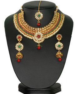 Charming fashion designer polki bridal jewelry set in golden background with Emerald,ruby and white stones-12SMBR2014