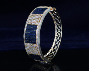 Gold plated Hinged clasp bangle with Sapphire Blue Stone
