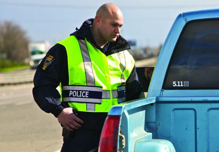 Police Officer with Hi Vis Clothing - Hi Vis Vest