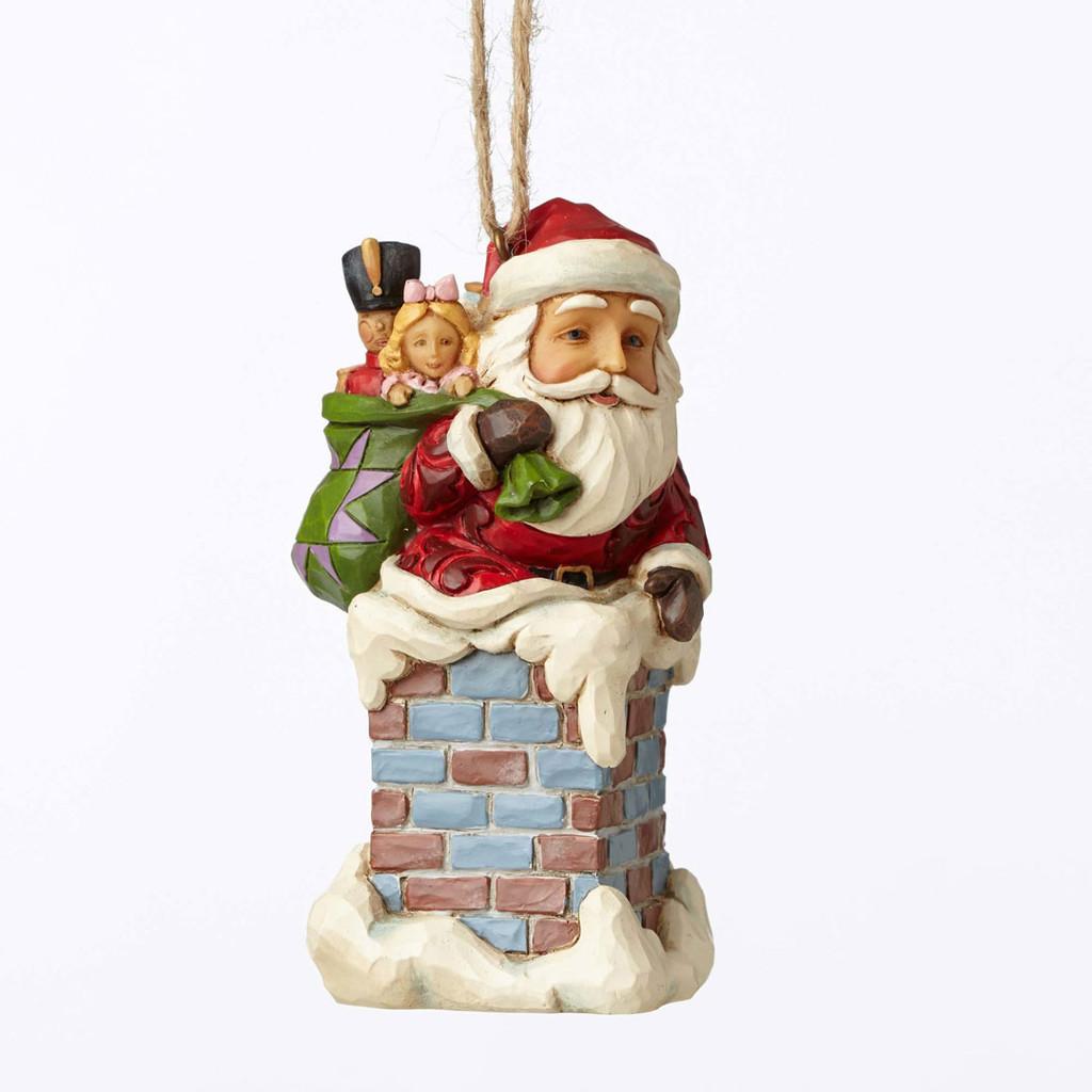 Jim Shore Heartwood Creek - Santa with Gifts Climbing Down Chimney Ornament