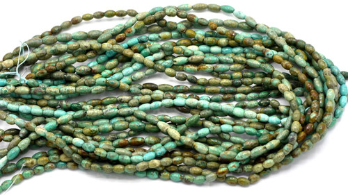 """15"""" 6-8mm Turquoise Oval Barrel Beads"""