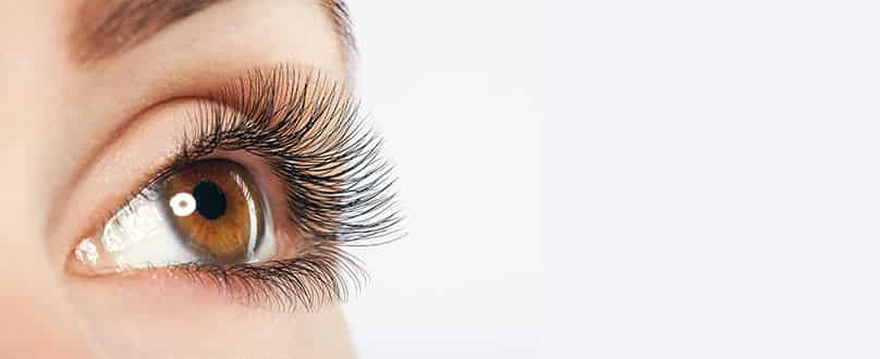 Woman wearing eyelash extensions