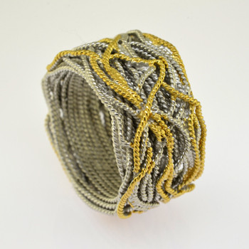 A very comfy, very stylish ring, woven in twisted Sterling Silver wire, and highlighted with 14 karat Yellow Gold electroplate. Measures 3/4 inch wide.  Standard size 7 1/2, or let us know what size you need. This ring is a special order item, please allow 4-6 weeks to arrive from Spain.  Handcrafted in Northern Spain.