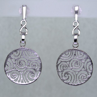 Light, airy, and easy to wear, these rhodium plated Sterling Silver earrings are just what you need when comfort and style are the order of the day. With a subtle textured finish, and clean modern filigree design, they are unobtrusive, and complimentory to any outfit. They dangle on posts, and measure 3/4 inch.  Handcrafted in Northern Spain.