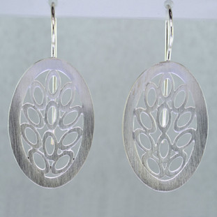 These oval, scalloped filagree design Sterling Silver earrings will make you shine in any outfit. Wear them with your jeans or for an evening out. With Sterling Silver ear wires. Measure 1 3/16 inches.  Handmade in Istanbul, Turkey.