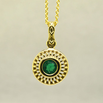 Blending traditional and modern for a timeless look, this diamond pendant dazzles day and night. Made in 18 karat Yellow Gold, with a vibrant .48ct. Emerald. This beautiful emerald pendant comes with an 18 karat Yellow Gold 1.3mm cable chain, 18 inches long. Pendant measures 3/4 inch long.   Designed, and created in our studio by the artist Stuart J.