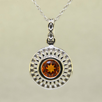 Blending traditional and modern for a timeless look, this diamond pendant dazzles day and night. Made in 14 karat White Gold, with a vibrant 1.17ct. Mandarin Garnet, custom cut for us by the famed stone cutters in Idar-Oberstein, Germany. This beautiful garnet pendant comes with a 14 karat White Gold, .07mm diamond cut wheat chain, 18 inches long. Pendant measures 3/4 inches long.    Designed, and created in our studio by the artist Stuart J.
