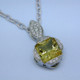 Eye-catching modern pendant with a traditional twist. Sculpted in 14 karat White Gold with a spectacular, one-of-a-kind 5.42ct. princess cut Yellow Beryl, custom cut for us by the famed stone cutters in Idar-Oberstein, Germany. Beryls come in many colors, the most familiar of which is green, which is Emerald. However the other colors are just as enticing, and much more unique. This fabulous gemstone is accented with .29ct. T.W. of Ideal cut Diamonds, and includes a 14 karat White Gold open link chain, 18 inches long. Pendant measures 1 1/8 inches long.  Designed, and created in our studio by the artist Stuart J.