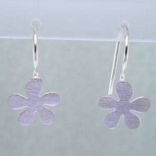 """Sweet flower earrings in sterling silver hanging on wires. Measures  3/4"""" long.  Hand crafted in Istanbul."""