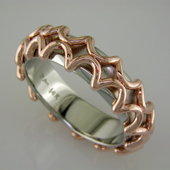 For the modern man, this ring is out of this world. 14 karat White Gold band with Rose Gold lattice pattern. Inside rounded band makes for added comfort.  This ring is a 10 1/2 and 7mm wide. This ring is custom made in your finger size, and takes about 2 weeks to create.  This is a special order item. Please call us to customize this ring just for you.  Designed, and created in our studio by the artist Stuart J.