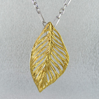 Everyday casual, or evening chic, you can't go wrong with this gold plated Sterling Silver leaf pendant. Includes the Sterling Silver 1.6mm snake chain, 18 inches long. The pendant measures 2 inches long.  Hand-crafted in Northern Spain.