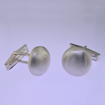 These solid Sterling Silver cufflinks look modern and sophisticated. Hand finished with a classic round shape, and light textured finish for an understated, but distinctive look. Measures 5/8 inch.  by David Heston of San Rafael, California.