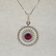 Mixing traditional with modern, this white gold pink tourmaline pendant is sophisticated and classy. Wear it any time, day or night. Crafted in 14 karat White Gold, set with a rich red .50ct. round pink Tourmaline gemstone, and surrounded by .22ct. T.W. of Ideal cut Diamonds. A delicate Diamond bail tops off this beautiful pendant. Includes a .07mm 14 karat White Gold Diamond cut wheat chain, 18 inches long. Measures 1 inch.  Designed, and created in our studio by the artist Stuart J.