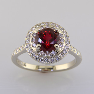 Timeless and elegant, this double halo ruby and diamond ring will never go out of style. Meticulously crafted in 14 karat white gold, with a deep red 1.50 carat Chatham Created Ruby, and .46ct T.W. of Ideal cut Diamonds. Measures 1/2 inch in diameter, in a size 6.5. Can be sized up or down. Also available with many other center gemstone options, by special order. Want it in platinum? We can do that too.  Please let us know how we can make this ring Perfectly You.  Designed, and created in our studio by the artist Stuart J.