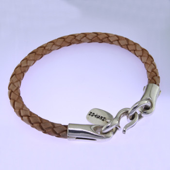 Modern but classic, this leather and Sterling Silver bracelet is perfect for everyday wear. Light tan leather with a bold Sterling Silver clasp. Uniquely designed for men or women. 1/4 inch thick and 8 inches long. Can be sized smaller only. Available in other colors. Call or email for other options.  by David Heston of San Rafael, California.