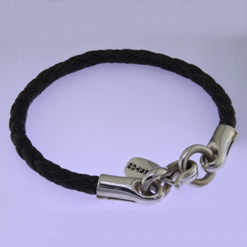Modern but classic, this leather and Sterling Silver bracelet is perfect for everyday wear. Dark brown leather with a bold Sterling Silver clasp. Uniquely designed for men or women. 1/4 inch thick and 8 inches long. Can be sized smaller only. Available in other colors. Call or email for other options.  by David Heston of San Rafael, California.