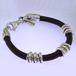 Edgy and modern, this leather and sterling silver man's bracelet makes a statement in a classy, understated way. The genuine leather measures 6.5mm in diameter, with solid sterling silver coils, and a sturdy clasp. Will fit an 8 inch wrist, and can be sized down only.  by David Heston of San Rafael, California.
