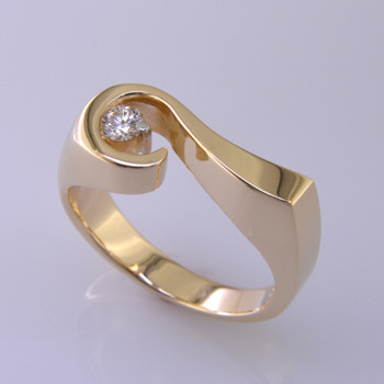 """Sweet, simple, modern diamond ring. Strong, yet feminine, and crafted in solid 14 karat Yellow Gold with a sparkling .12ct. Ideal cut Diamond, seemingly floating in space. Size 6 1/2, and can be sized up or down about 1.5 sizes. We can also make this diamond ring in any karat or color of gold, and in platinum, and with any gemstone. Please allow 2 weeks for us to make it Perfectly You. It will be worth it! Measures 1/4"""" wide.  Designed, and created in our studio by the artist Stuart J."""