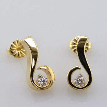 Sweet, simple, modern diamond earrings. Wear them for work or play. Crafted in 14 karat Yellow Gold with .20ct. T.W. Ideal cut Diamonds, with posts. Measure 1/2 inch long.  Designed, and created in our studio by the artist Stuart J.