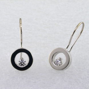 These floating diamond earrings are modern and timeless. Classic circles in 14 karat White Gold with .20ct. T.W. Ideal cut Diamonds, hanging on wires. Measure 3/4 inch long.  Designed, and created in our studio by the artist Stuart J.